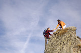 Couple climbing on summit