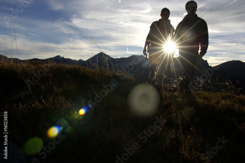 Couple standing in mountains in backlight