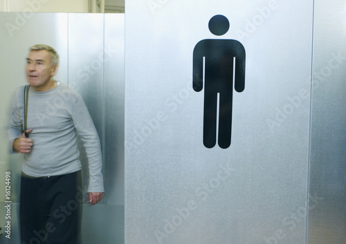 Man exiting gym locker room