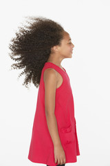 Young girl indoors with her hair blowing back