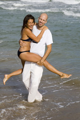 Young attractive couple on the beach