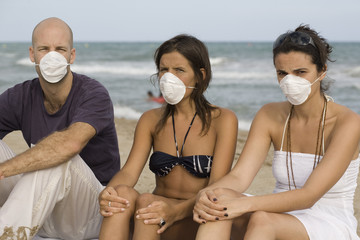 Three young adults with protection masks against birdflu