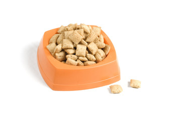 Kibbles in orange plastic bowl