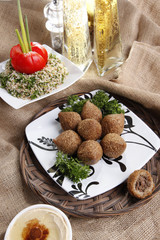 Middle eastern Fried Kibbe with Tabouli and Hummus Tahine