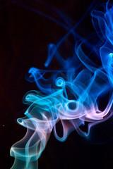 Blue smoke on black.