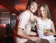 Couple by pool tables with beverage smiling