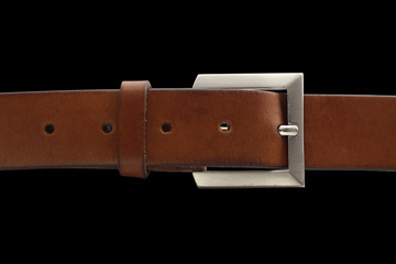 brown belt with buckle isolated on black with clipping path