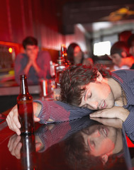 Man passed out on bar in nightclub