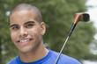 Teen boy golfing