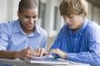 Teen boys studying