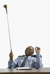 Businessman with his golf club