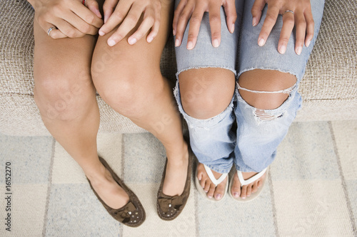 Two teen girls knees