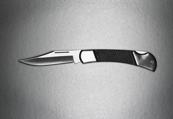 An open switchblade knife