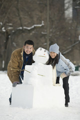 Couple making a snowman