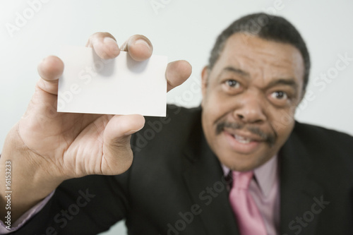Businessman holding a card
