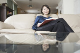 Asian woman relaxing with a book