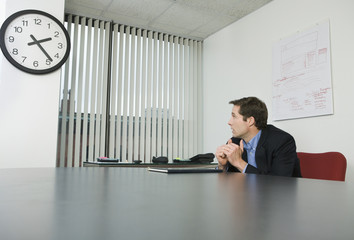 Businessman looking at a clock