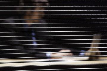 Businessman shot through windowpane using laptop