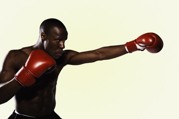 Boxer wearing gloves practicing punching