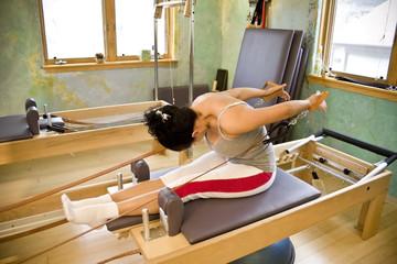 Young woman doing Pilates