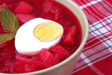 fresh beet vegetable soup in green bowl