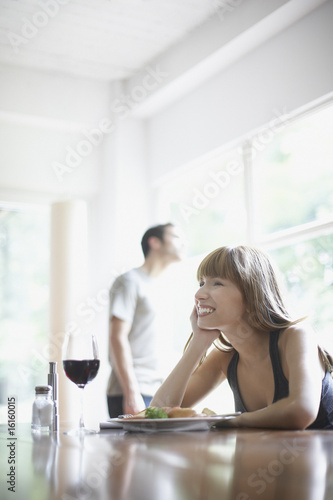 Woman sitting at dinner table smiling