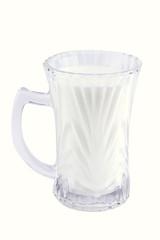 milk in transparent glass