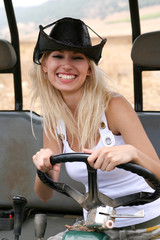 Female wearing cowboy hat riding quad