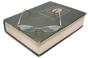 Glasses lying on an old book