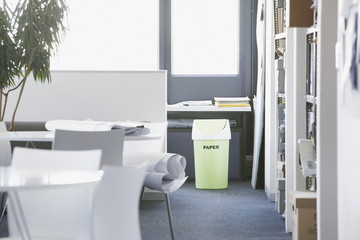 Green recycling bin in office