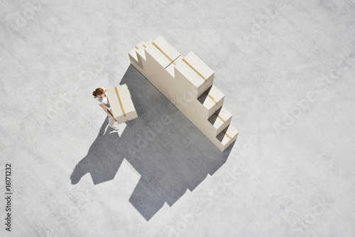 Woman stacking boxes