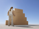 Woman stacking boxes in desert