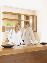 Couple looking at furniture brochure