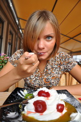 young woman eating ice-cream