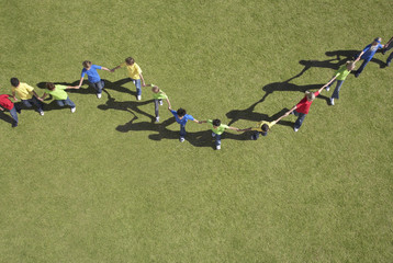 Group of children in line holding hands