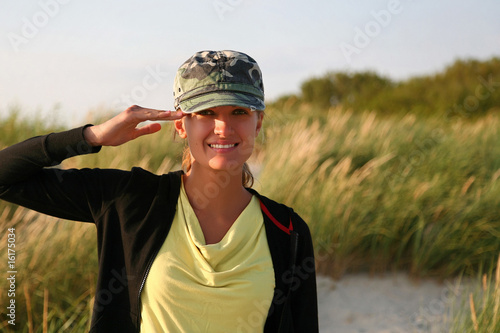 Beautiful woman with camouflage cap