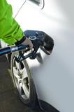 Man refilling petrol deposit poster