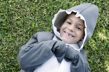 Young boy in shark costume