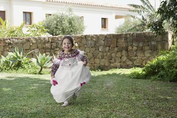 Young girl running in fancy dress