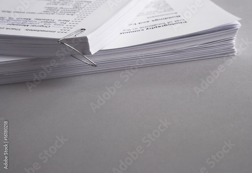 Close up of paperwork falling out of paperclip