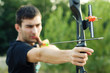 Attractive young archer sight his target