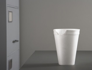 Close up of styrofoam cup with bite taken out