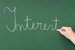 Interest written on a blackboard