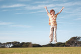 Boy jumping in mid-air