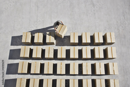 Man placing box into line