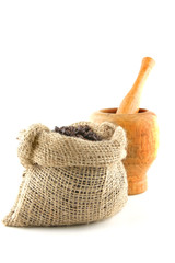 coffee bag full of beans with pestle