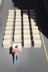 Man organizing boxes
