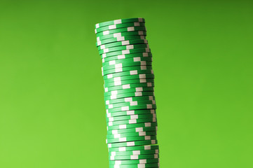Stack of casino chips against green background