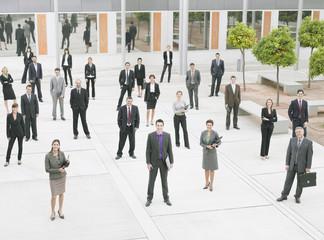 Businesspeople in modern office courtyard