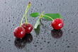 Three wet red cherries.